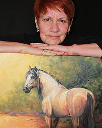 Photo of Marti Adrian Gregory with painting